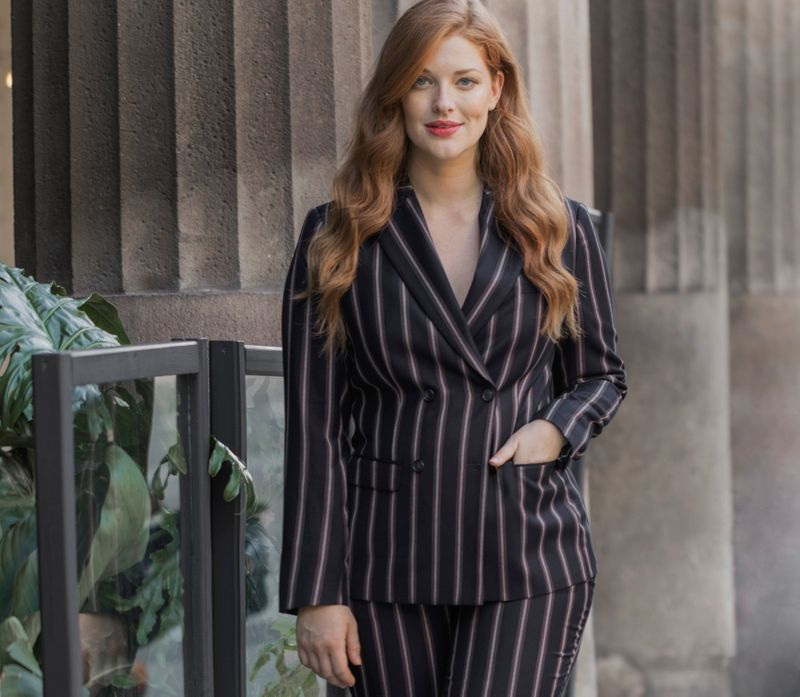 The pinstriped blazer everyone is wearing